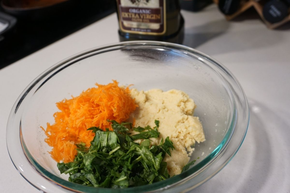 carrots spinach and semolina mix in a bowl
