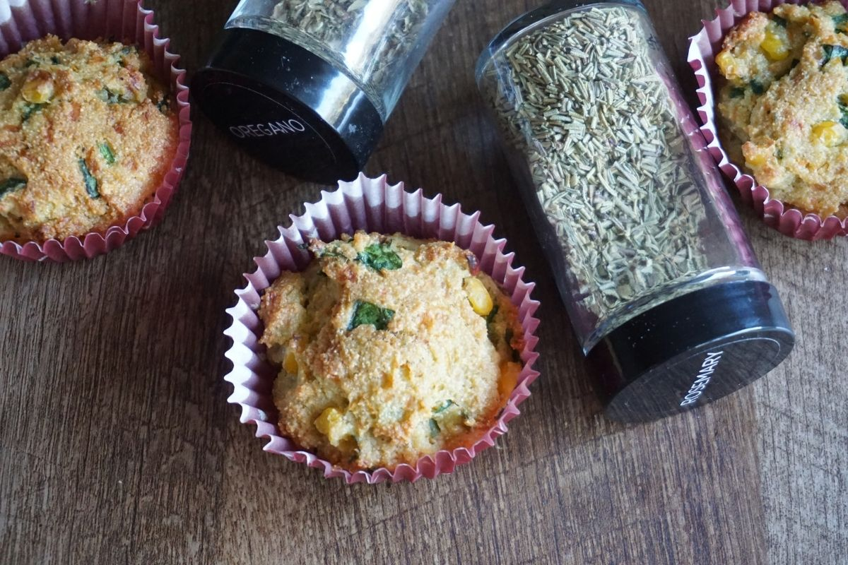 semolina muffins on table with herbs in bottles