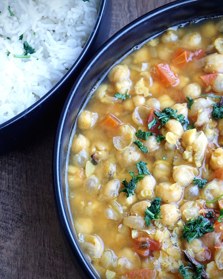 oil free chana masala in bowl and rice in a bowl