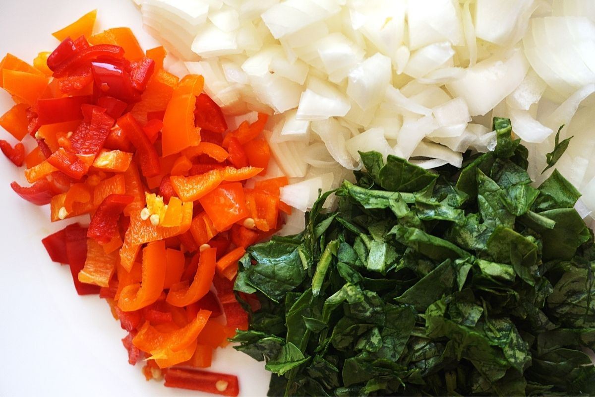 Chopped onions, sweet peppers and spinach.