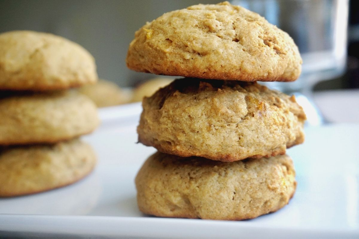stack of three banana biscuits with a blurred stack at the back