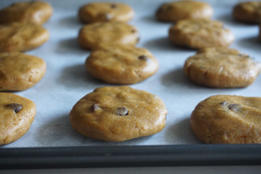flattened cookies on baking tray