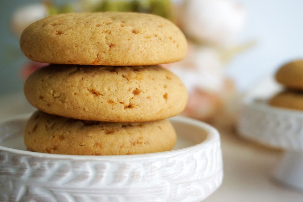 Stacked Atta Cookies on a stand.