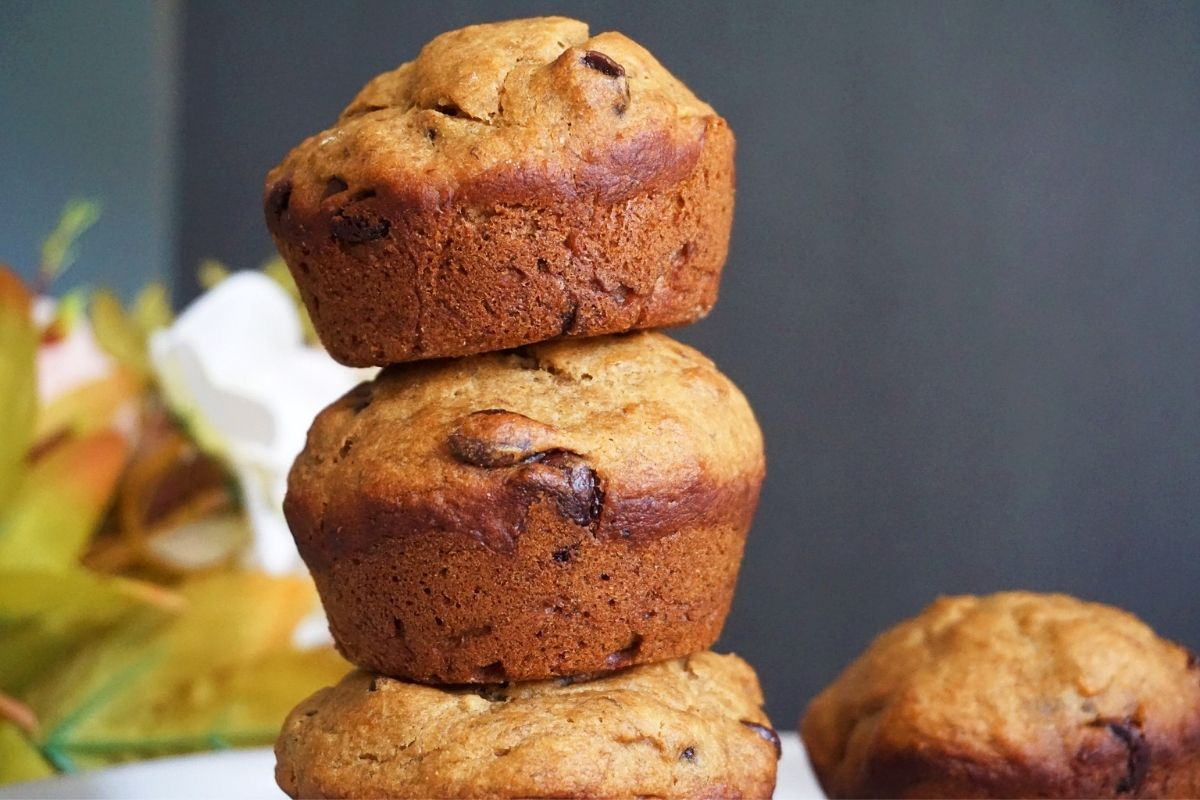 Stack of banana muffins with one one side